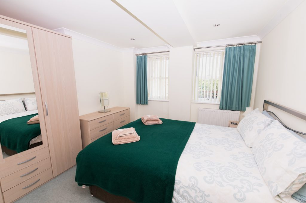 Master Bedroom with double bed chest of drawers, and a wardrobe