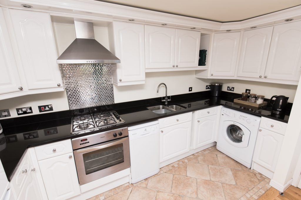 Kitchen, Oven with Gas hob and overhead extractor. Dual sink and mixer taps, dish washer and washing machine.