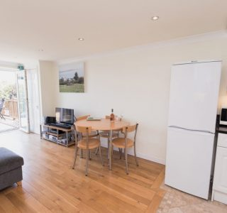 Open plan living, dining and kitchen At Balcony View