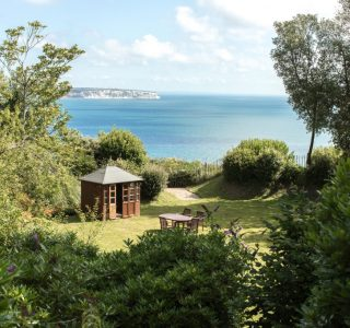 Summer house in the garden. View of Sandown Bay and Culver Cliff.