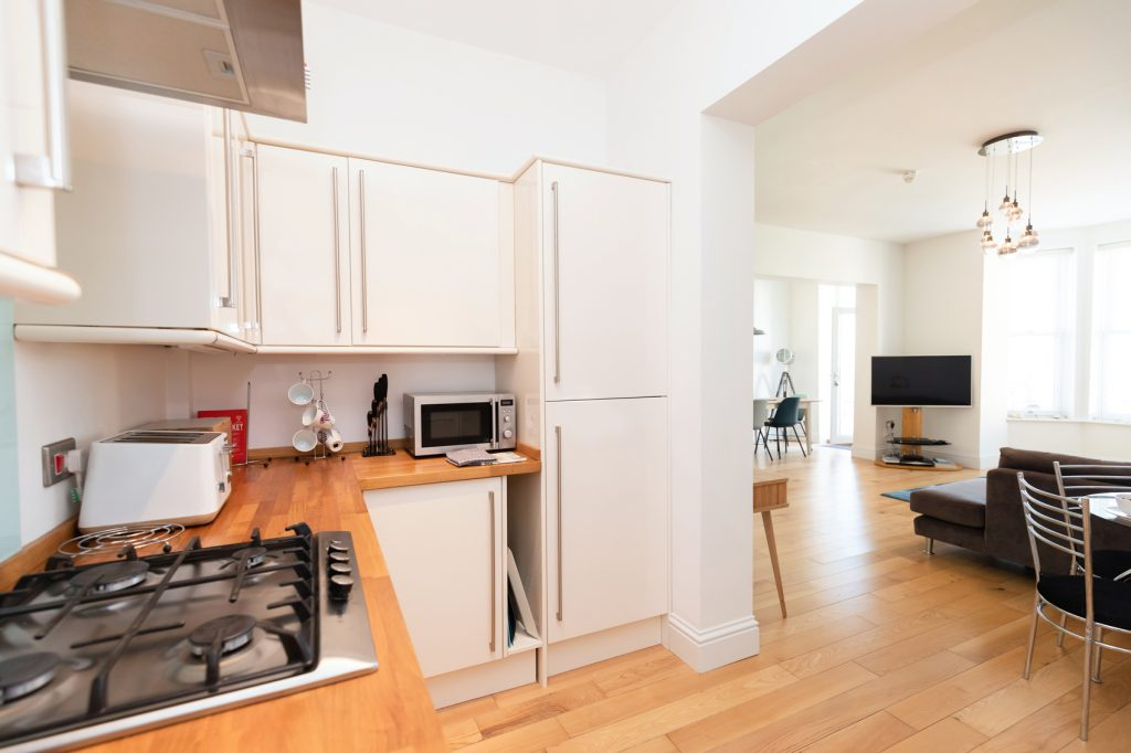 Image of Beach Views kitchen area, stocked with a toaster, kettle, gas hob, fridge/freezer and plenty of cupboard space, open plan with the dining and living area