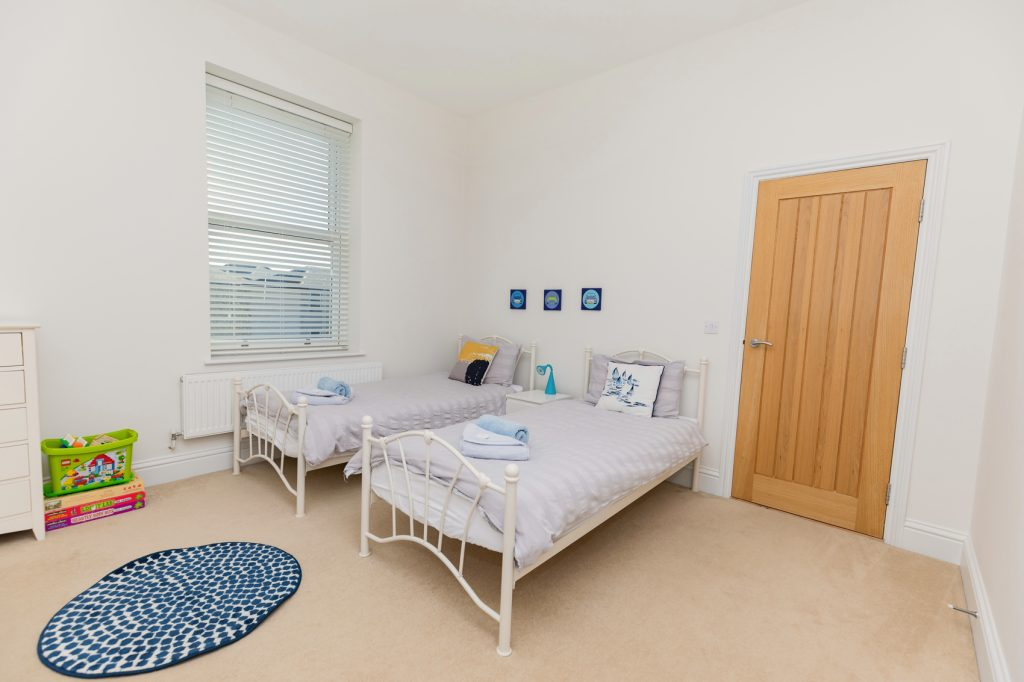 Twin room at Beach View two single beds with bed side tables and wardrobe/drawer space