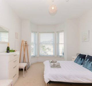 Beach View Master Bedroom with drawers and a coat rail