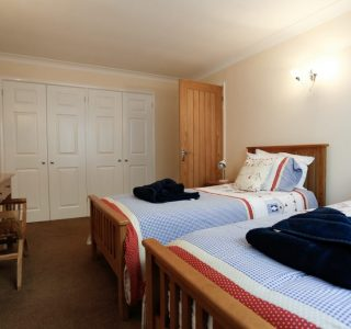 Twin bedroom, 2 single beds with cupboard space at the back of the room