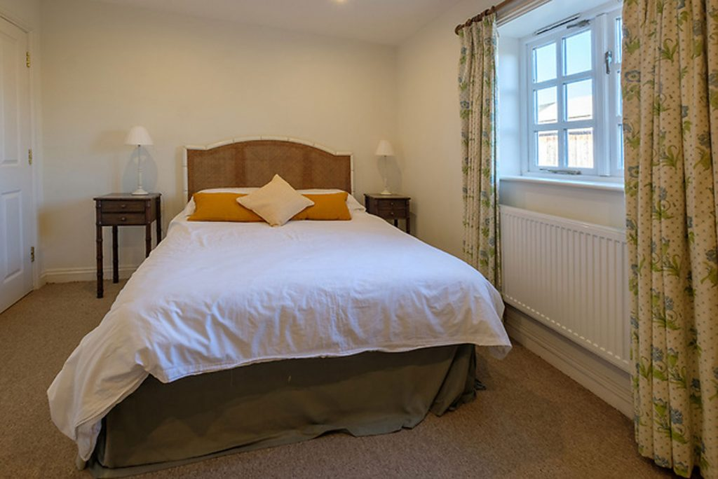 Shalfleet Barn Master bedroom complete with bed side tables and wardrobe