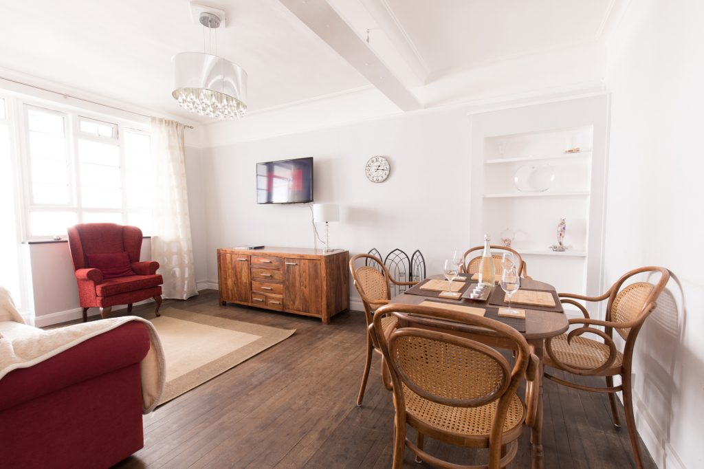 Open plan dining and living area, seating for 4 people.