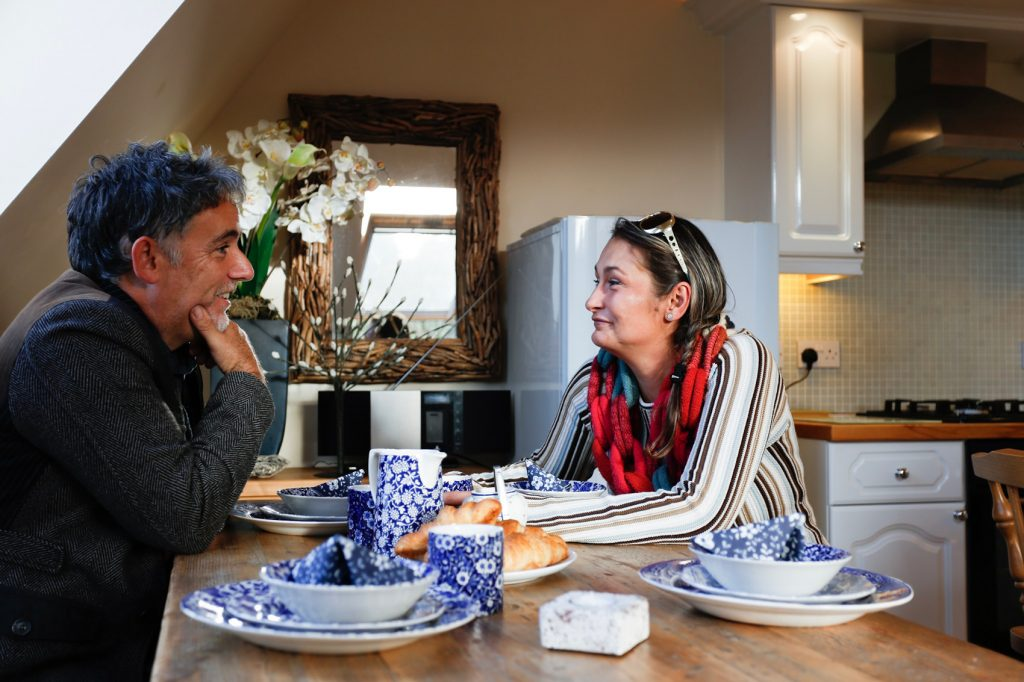 Couple enjoying breakfast in the dining area of Skylight View