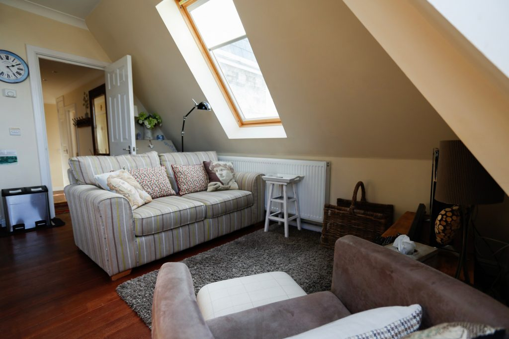 Living area of Skylight View, 2 seater sofa with an arm chair in front