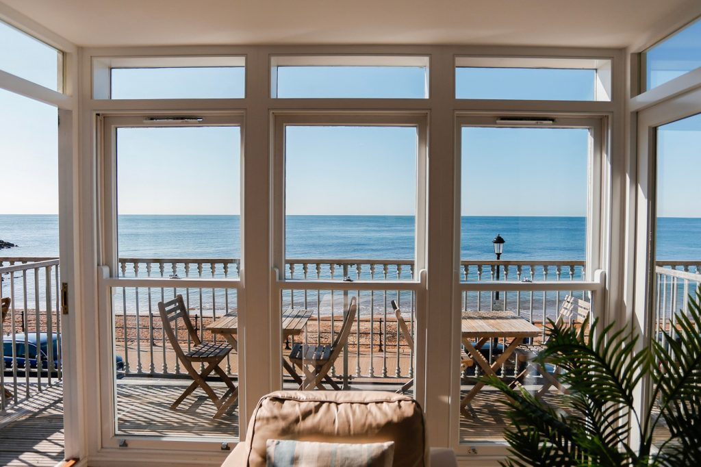 Balcony doors with views across the whole seafront