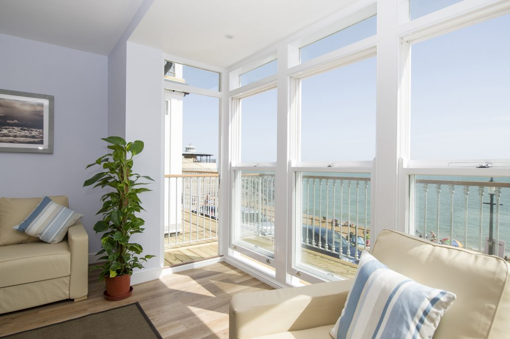 Open plan living area with TV mounted to the wall with view of Ventnor beach