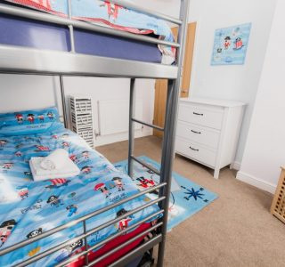 Bunk beds with TV and chest of drawers