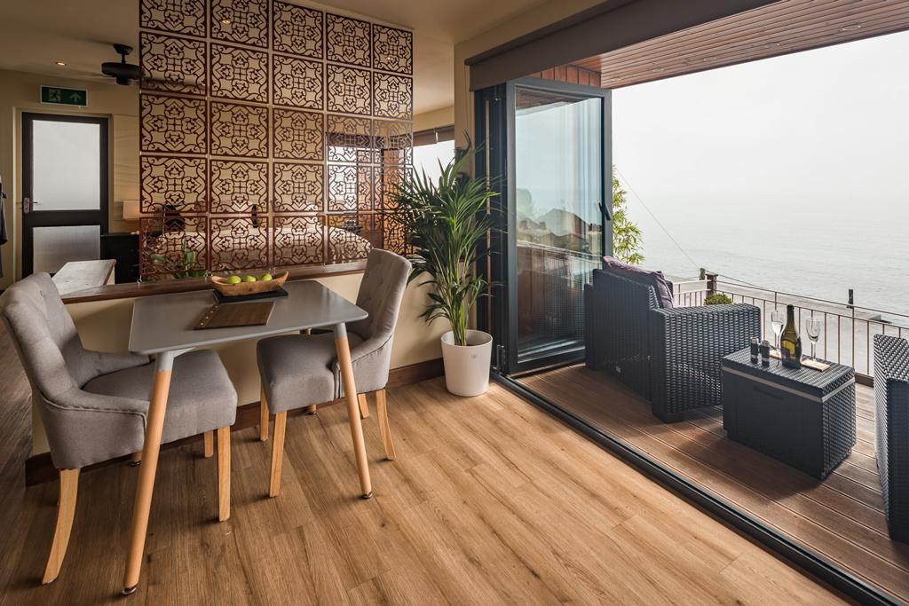 Ocean Suite view of living area with folding door open