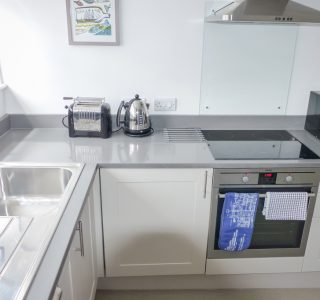 Franks Kitchen Area, Sink with mixer tap, toaster, kettle, electric oven and hob with microwave pictured.