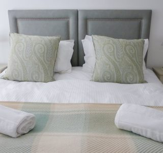 Franks Master Bedroom, close up shot of the Kingsize bed with bedside tables and lamps pictured either side.
