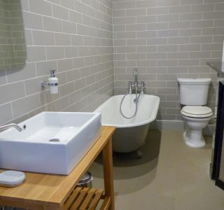 Family bathroom, square wash basin with singular mixer tap, bath and W/C