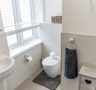Family Bathroom with toilet, wash basin with singular mixer tap.